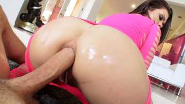 Brunette in pink Kimber Woods shares her big ass in reverse cowgirl pose