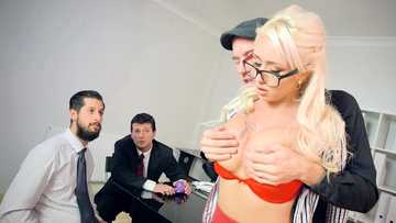Curly blonde Christina Shine sucks Danny D's cock in the office room while others are watching