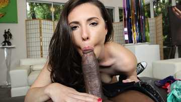 Wonderful brunette Casey Calvert is giving an interracial blowjob
