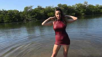 Big tits Ashley Adams showing off in a wet dress