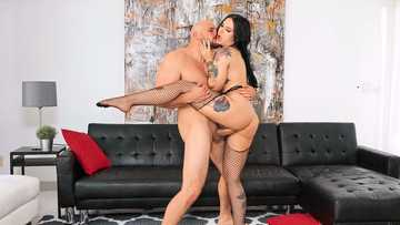 Bald stallion with beard satisfies pussy of the brunette Stella Raee in fishnets